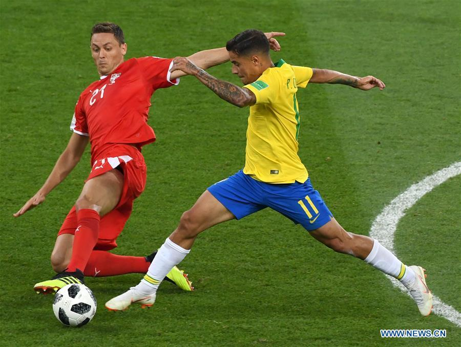 Philippe Coutinho (R) of Brazil vies with Nemanja Matic of Serbia during the 2018 FIFA World Cup Group E match between Brazil and Serbia in Moscow, Russia, June 27, 2018. Brazil won 2-0 and advanced to the round of 16. (Xinhua/Wang Yuguo)