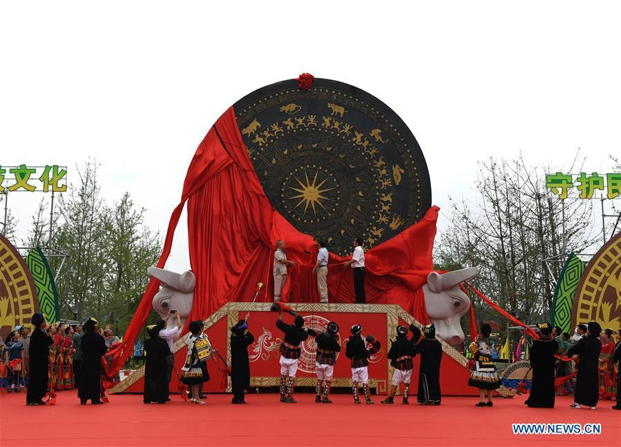 People unveil a gigantic bronze drum in Huanjiang Maonan Autonomous County, south China\'s Guangxi Zhuang Autonomous Region, June 29, 2018. The drum measures 6.68 meters in diameter and weighs 50 tons. It was recognized as the largest bronze drum by Guinness World Records. (Xinhua/Zhou Hua)