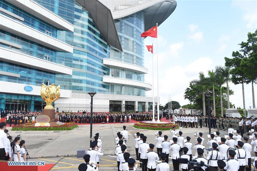 A flag-raising ceremony is held at Golden Bauhinia Square to celebrate the 21st anniversary of Hong Kong\'s return to the motherland, in Hong Kong, south China, July 1, 2018. (Xinhua/Qin Qing)