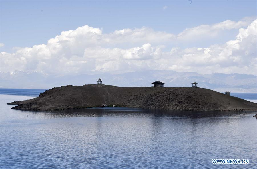 An island is seen on the Sayram Lake in northwest China\'s Xinjiang Uygur Autonomous Region, June 29, 2018. (Xinhua/Zhao Ge)