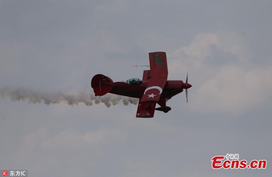Semin Ozturk, Turkey\'s first professional female aerobatic pilot performs aerobatic flight within the World Pilots Day at the International Sportive Aviation Center, in Sivrihisar district of Eskisehir, Turkey, May 5, 2018. (Photo/IC)
