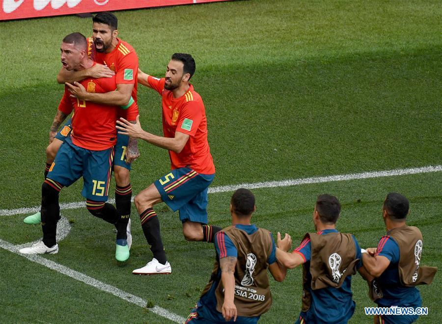 Players of Spain celebrate after Russia\'s Sergey Ignashevich scored an own goal during the 2018 FIFA World Cup round of 16 match between Spain and Russia in Moscow, Russia, July 1, 2018. (Xinhua/Wang Yuguo)