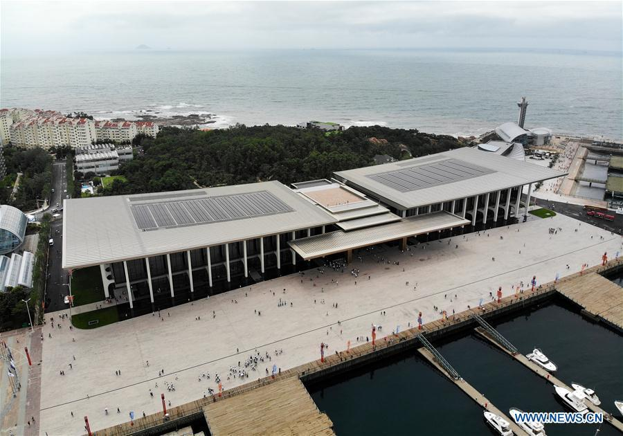 Aerial photo taken on July 1, 2018 shows the Olympic sailing center in Qingdao of east China\'s Shandong Province. The center, used as the conference hall during the 18th Shanghai Cooperation Organization (SCO) summit, after a brief remodification, was opened to the public from this Sunday. (Xinhua/Li Ziheng)