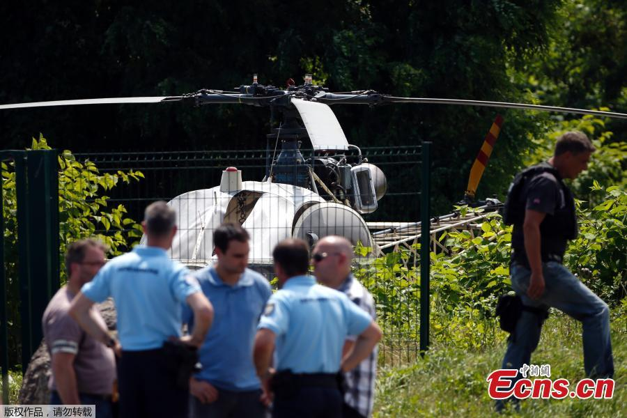 Photo taken on July 1, 2018 in Gonesse, north of Paris shows police near a French helicopter Alouette II abandoned by French armed robber Redoine Faid after his escape from prison in Reau. Redoine Faid was flown out of Réau prison with the help of three heavily-armed accomplices, security sources say. (Photo/Agencies)