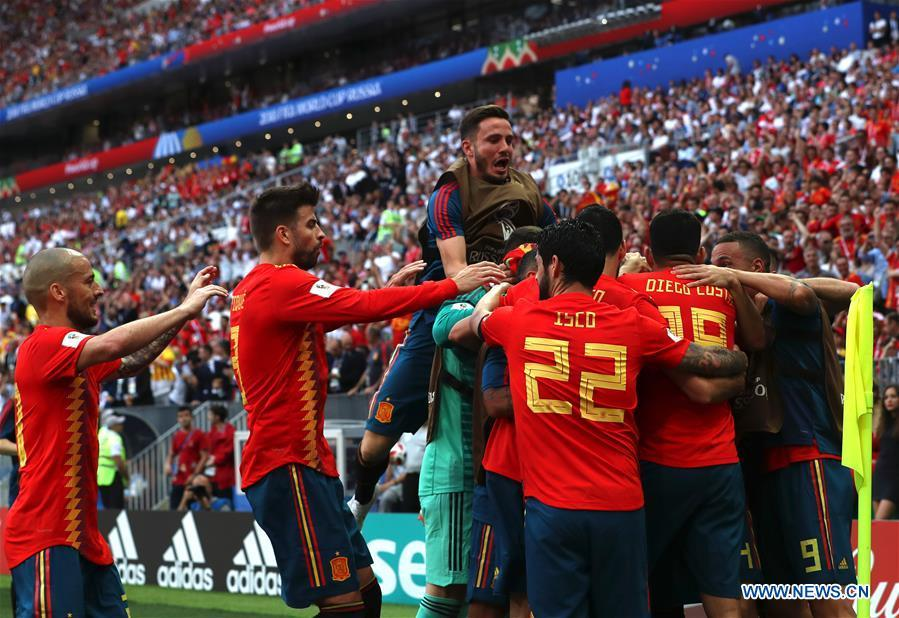 Players of Spain celebrate after Russia\'s Sergey Ignashevich scored an own goal during the 2018 FIFA World Cup round of 16 match between Spain and Russia in Moscow, Russia, July 1, 2018. (Xinhua/Cao Can)