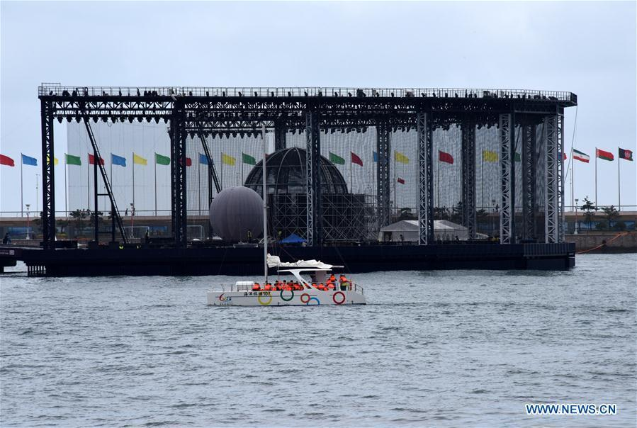 Visitors take a boat trip around the Olympic sailing center in Qingdao of east China\'s Shandong Province, July 1, 2018. The center, used as the conference hall during the 18th Shanghai Cooperation Organization (SCO) summit, after a brief remodification, was opened to the public from this Sunday. (Xinhua/Li Ziheng)