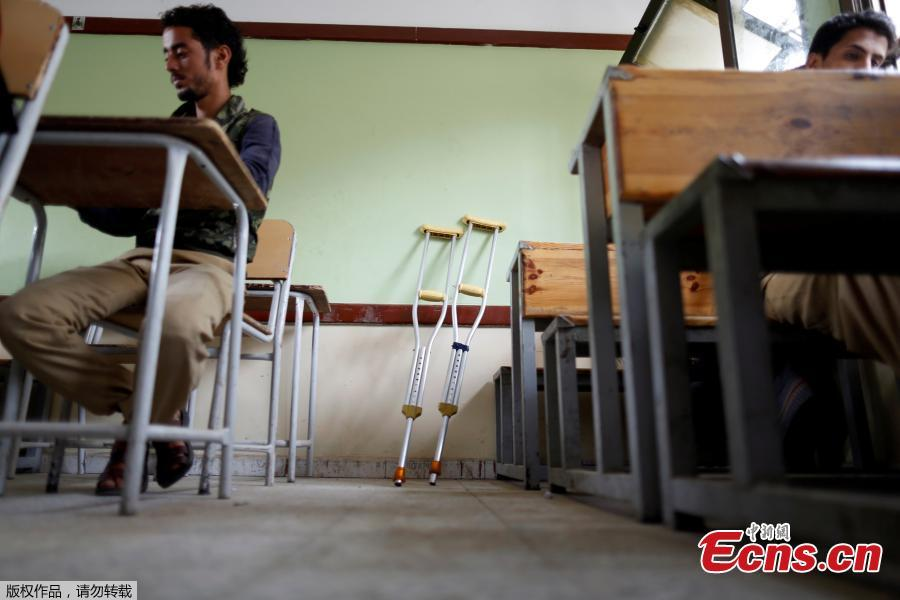 Crutches are seen in a classroom where students are taking their final term exam of high school in Sanaa, Yemen, June 30, 2018. (Photo/Agencies)