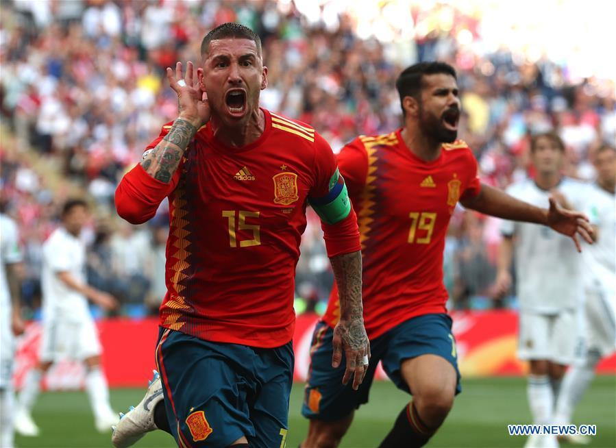 Sergio Ramos (L) of Spain celebrates after Russia\'s Sergey Ignashevich scored an own goal during the 2018 FIFA World Cup round of 16 match between Spain and Russia in Moscow, Russia, July 1, 2018. (Xinhua/Cao Can)