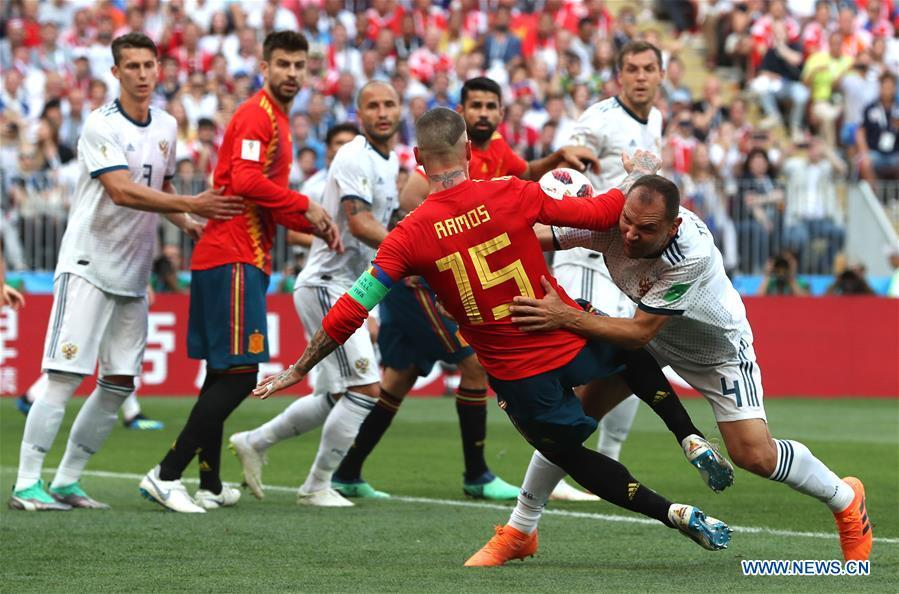 Sergey Ignashevich (R bottom) of Russia scores an own goal during the 2018 FIFA World Cup round of 16 match between Spain and Russia in Moscow, Russia, July 1, 2018. (Xinhua/Cao Can)