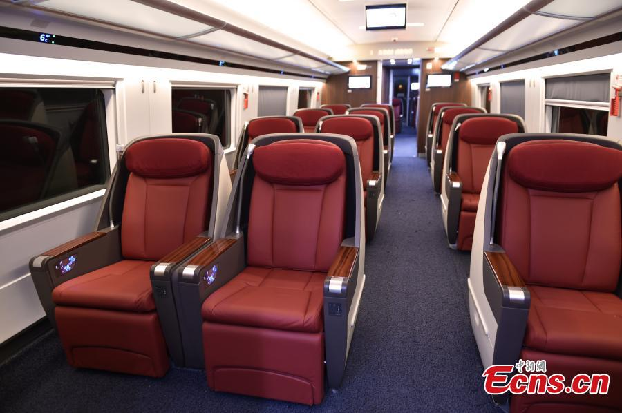 A view of the interior of the extended version of the Fuxing bullet train in Daxing District, Beijing. With a designed speed of 350 kilometers per hour, the new train is 414.26 meters long with 16 carriages, twice as many as the current Fuxing. It has 1,193 seats.  (Photo: China News Service/Zhai Lu)