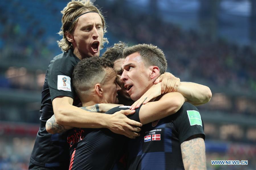 Players of Croatia celebrate Mario Mandzukic\'s goal during the 2018 FIFA World Cup round of 16 match between Croatia and Denmark in Nizhny Novgorod, Russia, July 1, 2018. (Xinhua/Bai Xueqi)