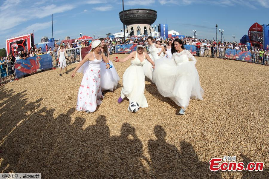 Women wearing wedding dresses take part in the so-called \