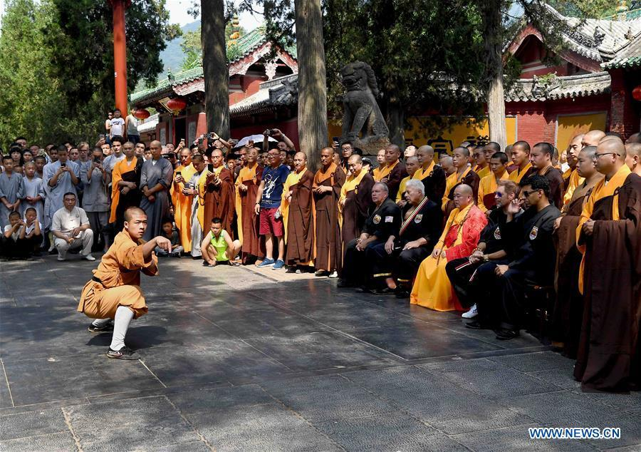 A monk performs martial arts at Shaolin Temple on the Mount Songshan, central China\'s Henan Province, July 1, 2018. Over 200 Kungfu enthusiasts from America made a trip to the Shaolin Temple and performed martial arts with local monks. (Xinhua/Li An)