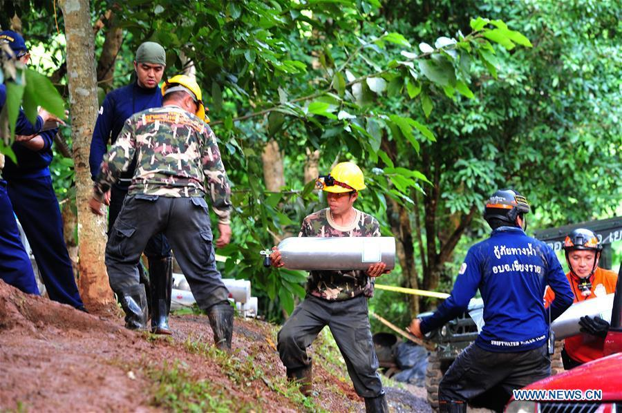 Rescuers search for the 12 teenagers and their football coach who went missing in Mae Sai, Chiang Rai province, in northern Thailand, July 2, 2018. Twelve teenagers and their football coach, trapped in a cave in northern Thailand for nine days, have been found alive on Monday night, Narongsak Osottanakorn, governor of Chiang Rai province said. (Xinhua/Rachen Sageamsak)