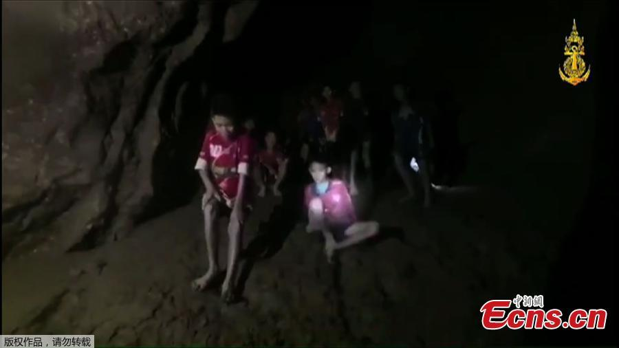 This video grab taken from footage released by The Royal Thai Navy late July 2, 2018, shows missing children inside the Tham Luang cave of Khun Nam Nang Non Forest Park in the Mae Sai district of Chiang Rai province. Twelve boys and their football coach trapped in a flooded Thai cave for ten days were found alive after a painstaking search by specialist divers who finally discovered the emaciated group on a mud embankment.(Photo/Agencies)
