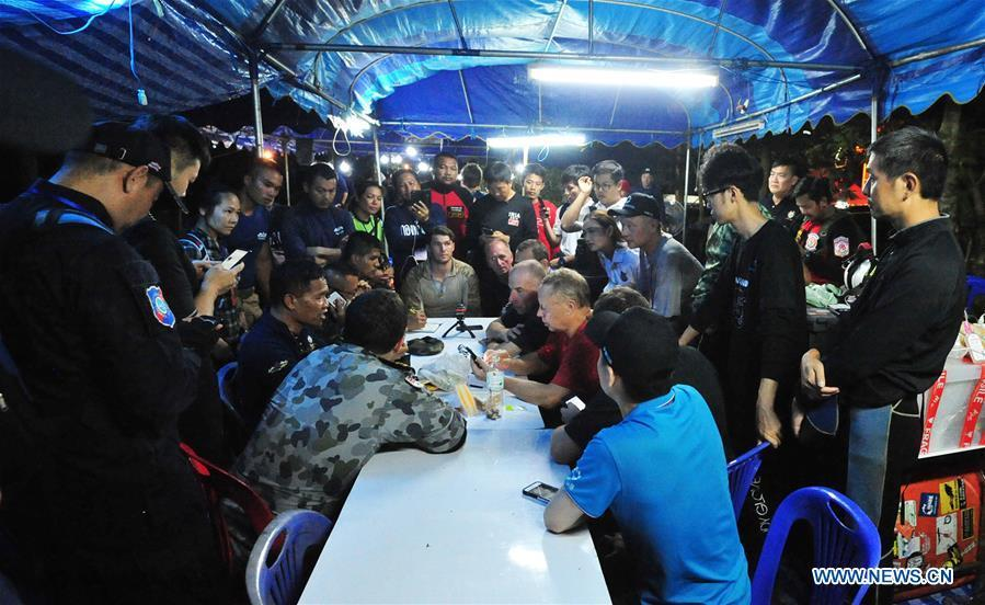 A rescuer briefs the press about the condition of the 12 teenagers and their football coach in Mae Sai, Chiang Rai province, northern Thailand, on July 2, 2018. Twelve teenagers and their football coach, trapped in a cave in northern Thailand for nine days, have been found alive on Monday night, Narongsak Osottanakorn, governor of Chiang Rai province said. (Xinhua/Rachen Sageamsak)
