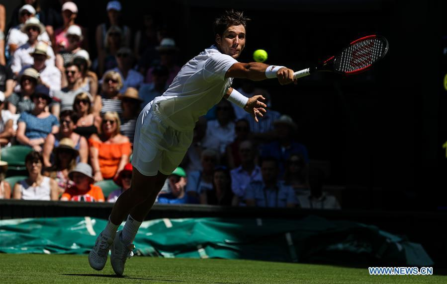 Dusan Lajovic of Serbia hits a return during the men\'s singles first round match against Roger Federer of Switzerland at the Championship Wimbledon 2018 in London, Britain, on July 2, 2018. Dusan Lajovic lost 0-3. (Xinhua/Tang Shi)