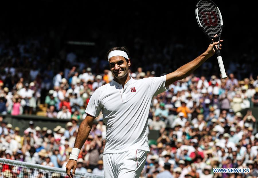Roger Federer of Switzerland celebrates after winning the men\'s singles first round match against Dusan Lajovic of Serbia at the Championship Wimbledon 2018 in London, Britain, on July 2, 2018. Roger Federer won 3-0. (Xinhua/Tang Shi)