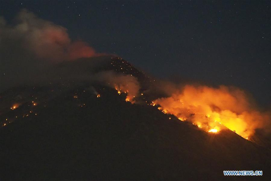 Mount Agung volcano erupts at Lempuyangan Village in Karangasem, Bali of Indonesia, July 2, 2018. The Mount Agung volcano erupted on Monday evening, hurling lava down its slopes.(Xinhua/Monstar Simanjuntak)