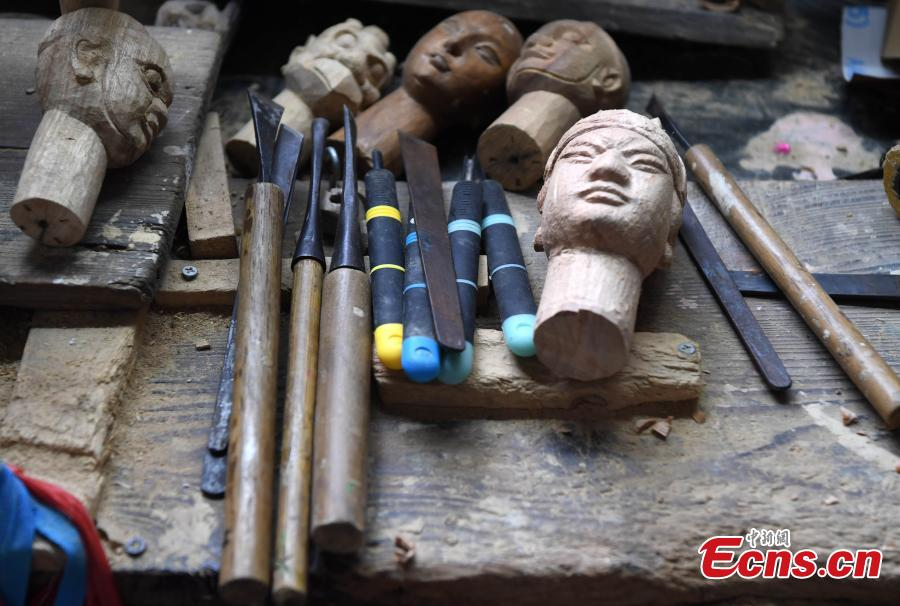 Tools used by folk artist Yang Yazhou to make puppet heads are displayed in his studio in Zhangzhou City, East China's Fujian Province, July 1, 2018. Zhangzhou has a history of puppetry going back more than two thousand years. Yang represents the fifth generation of his family to be involved with Fuchun-style glove puppets show, an intangible cultural heritage. He began learning to carve puppet heads when he was nine years old, taught by several masters. Yang said it takes tens of steps to finish carving a puppet-head in about three days. Yang's sister specializes in dressing the puppets, his brother in puppet performance. (Photo: China News Service/Zhang Bin)