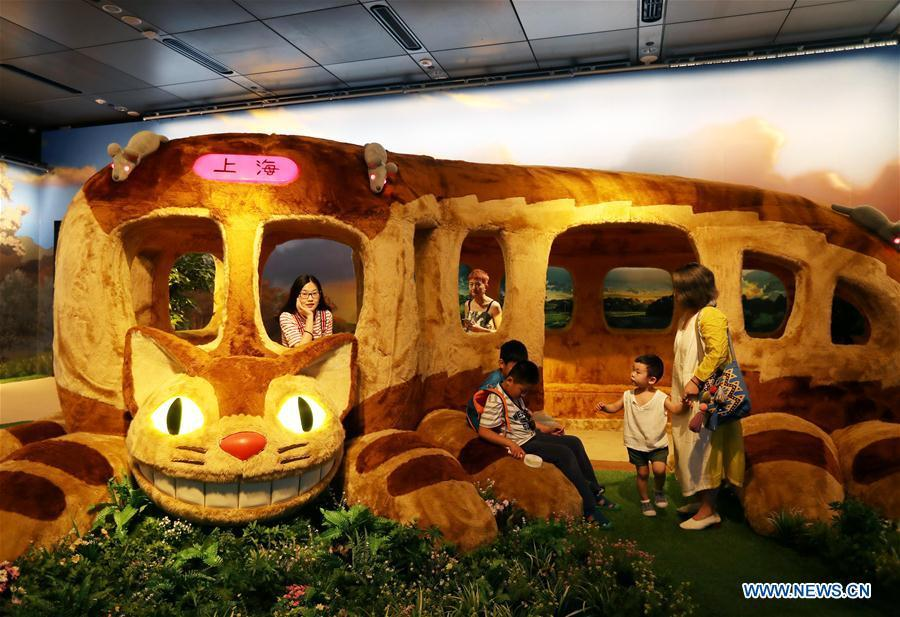 Visitors view the Catbus, a cartoon figure in the Japanese animation fantasy film \