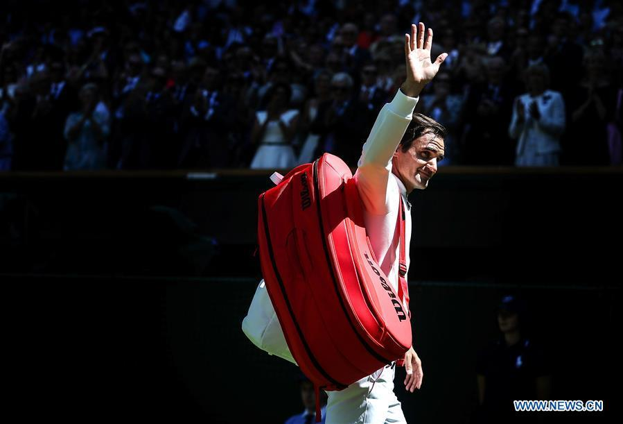Roger Federer of Switzerland greets spectators after winning the men\'s singles first round match against Dusan Lajovic of Serbia at the Championship Wimbledon 2018 in London, Britain, on July 2, 2018. Roger Federer won 3-0. (Xinhua/Tang Shi)