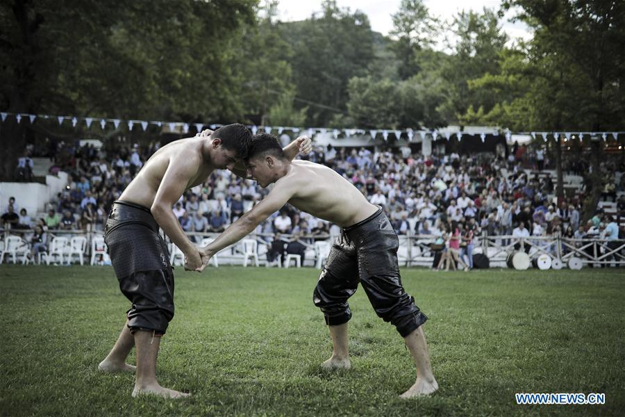 Photo taken on June 30, 2018, shows wrestlers participate in traditional oil wrestling competition in the village of Sohos, Thessaloniki, Greece. (Xinhua/ Dimitris Tosidis)