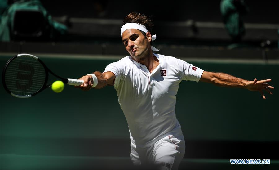 Roger Federer of Switzerland hits a return during the men\'s singles first round match against Dusan Lajovic of Serbia at the Championship Wimbledon 2018 in London, Britain, on July 2, 2018. Roger Federer won 3-0. (Xinhua/Tang Shi)