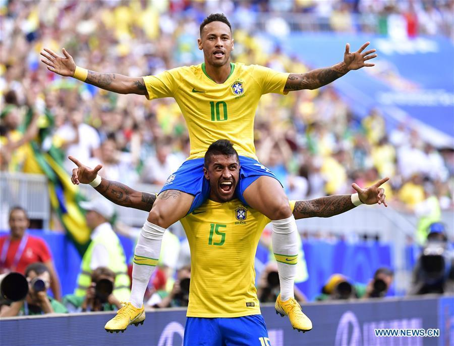 Neymar (top) of Brazil celebrates scoring with Paulinho during the 2018 FIFA World Cup round of 16 match between Brazil and Mexico in Samara, Russia, July 2, 2018. (Xinhua/Chen Yichen)