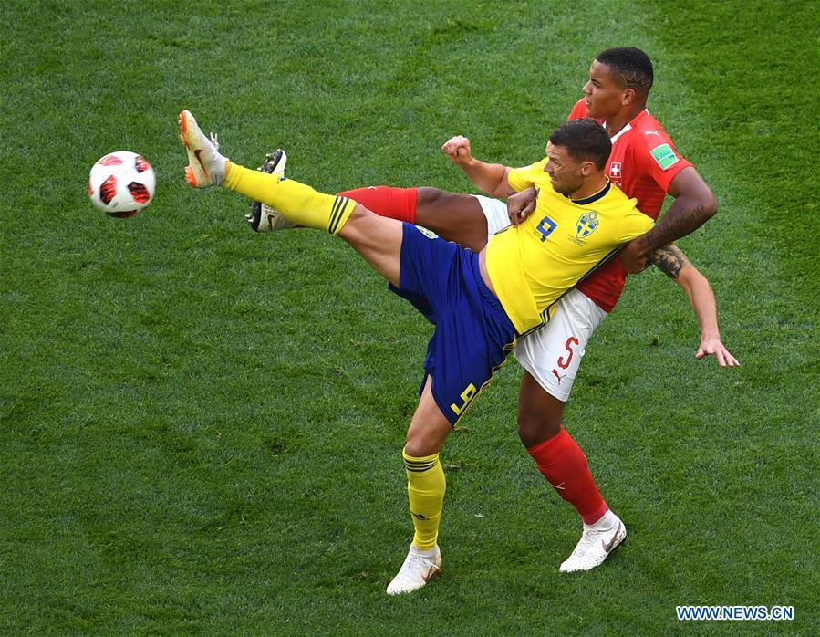 Manuel Akanji (top) of Switzerland vies with Marcus Berg of Sweden during the 2018 FIFA World Cup round of 16 match between Switzerland and Sweden in Saint Petersburg, Russia, July 3, 2018. (Xinhua/Wang Yuguo)