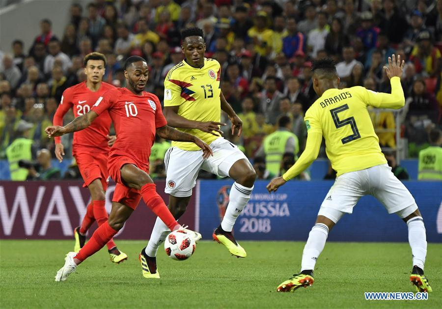 Raheem Sterling (2nd L) of England vies with Yerry Mina (2nd R) of Colombia during the 2018 FIFA World Cup round of 16 match between England and Colombia in Moscow, Russia, July 3, 2018. (Xinhua/He Canling)