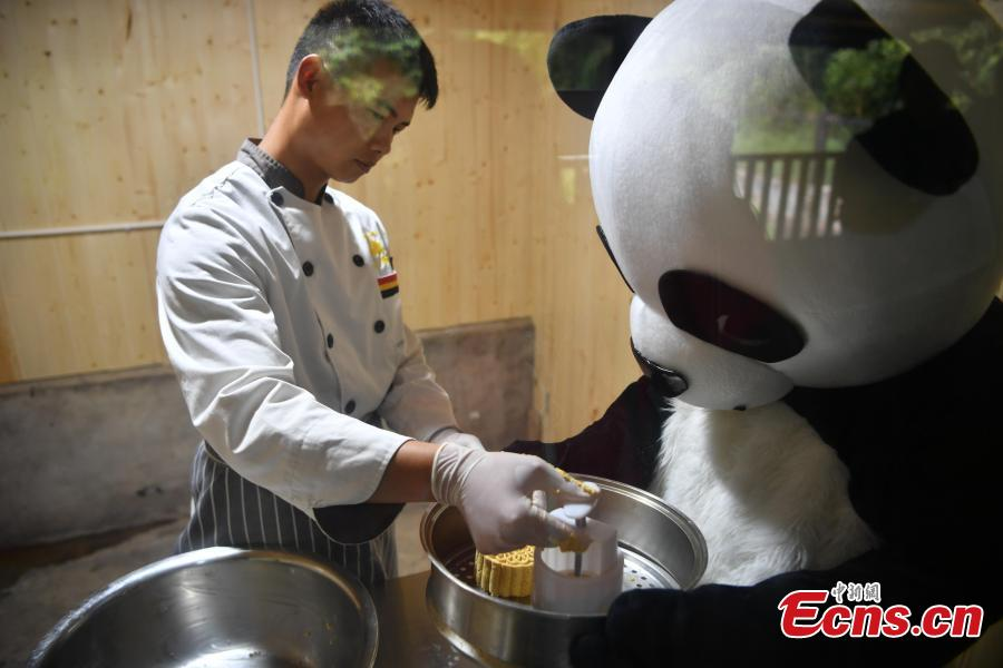 Keepers prepare food for giant pandas at the Yunnan Wildlife Park in Kunming City, Southwest China's Yunnan Province, July 3, 2018. The park has opened a panda kitchen where visitors can see how keepers prepare food for the animals and also participate in the preparation process in the future. (Photo: China News Service/Liu Ranyang)