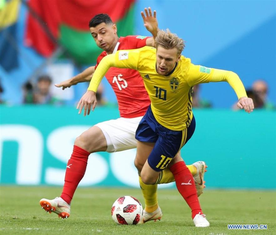 Blerim Dzemaili (L) of Switzerland vies with Emil Forsberg of Sweden during the 2018 FIFA World Cup round of 16 match between Switzerland and Sweden in Saint Petersburg, Russia, July 3, 2018. (Xinhua/Xu Zijian)