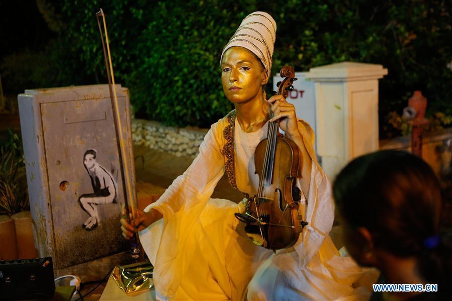 An artist performs during the International Festival of Living Statues in Rehovot, Israel, on July 4, 2018. The International Festival of Living Statues is held in Rehovot from July 3 to July 5. (Xinhua/Gil Cohen Magen)