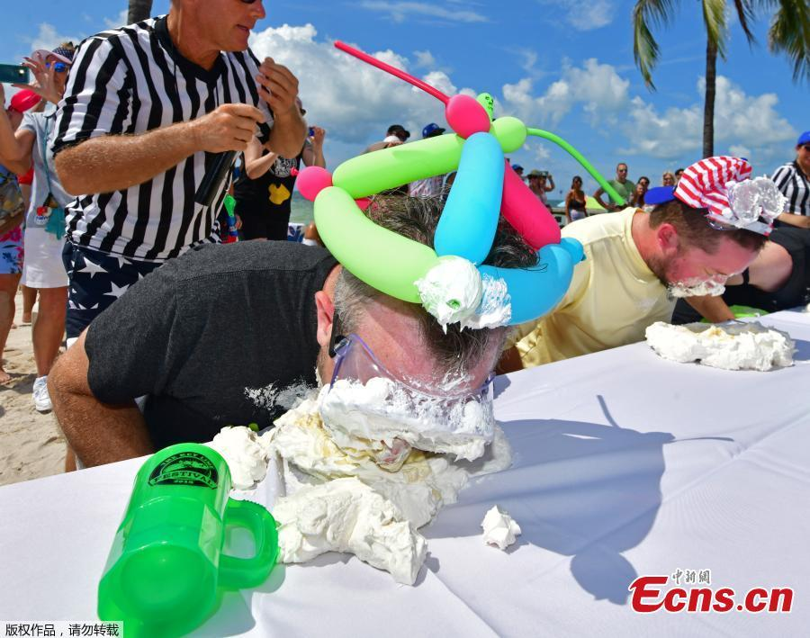 Photo taken on July 4, 2018 shows Trey Bergman, a lawyer of Houston, won Key West\'s annual Key lime pie eating contest for the second year in a row, scarfing down the signature Florida dessert in less than two minutes. Without using his hands, Trey Bergman defeated 24 other contenders for the title. Clad in protective googles and a \