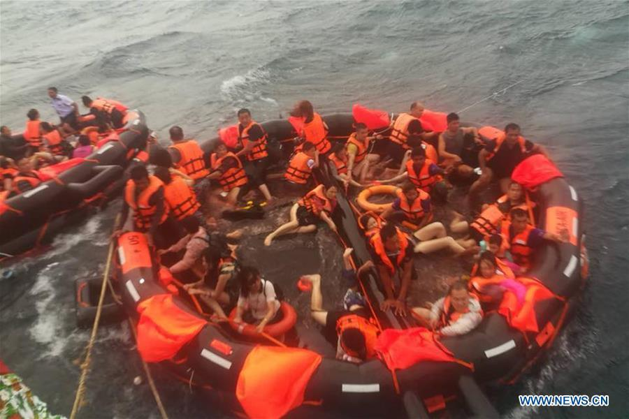 Rescued tourists are seen on life rafts near the island of Phuket, Thailand, July 5, 2018. Until 8:30 p.m. local time (1330 GMT) Thursday, the majority of 133 passengers on two boats overturned by rough seas in southern Thailand were saved, but the Thai authority cannot confirm all of them are saved now, said Chinese Consulate-General in Songkhla on Thursday.(Xinhua)