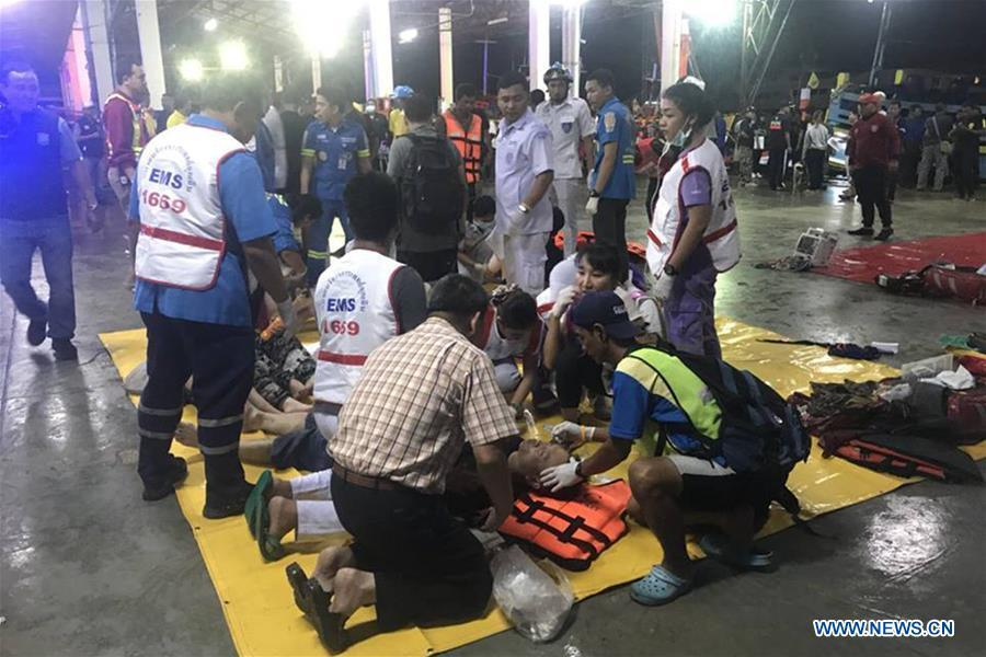 Rescued tourists receive medical treatment on the island of Phuket, Thailand, July 5, 2018. Until 8:30 p.m. local time (1330 GMT) Thursday, the majority of 133 passengers on two boats overturned by rough seas in southern Thailand were saved, but the Thai authority cannot confirm all of them are saved now, said Chinese Consulate-General in Songkhla on Thursday.(Xinhua)