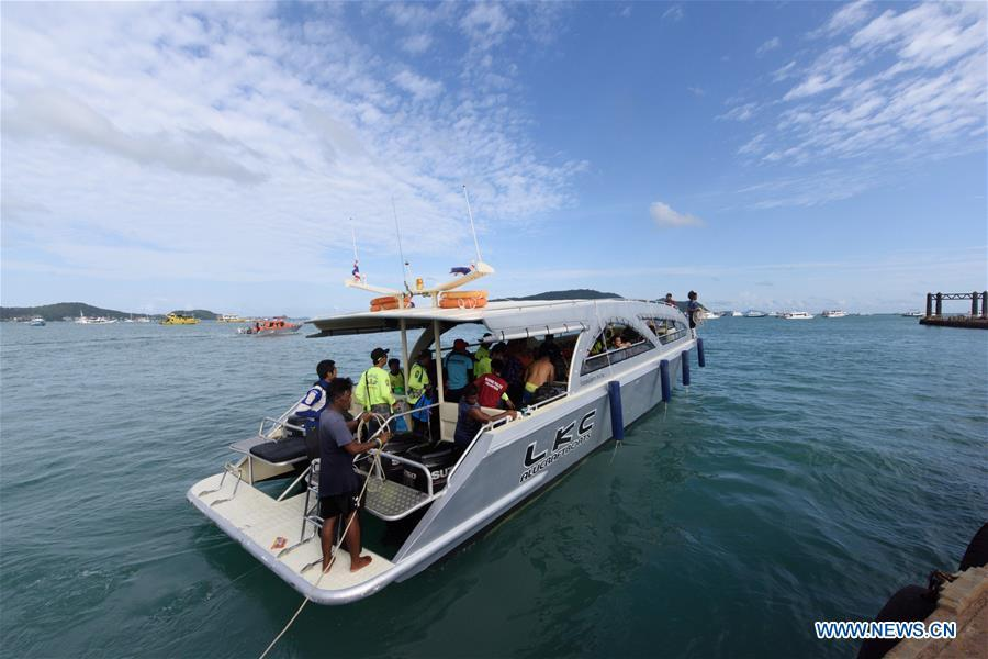 A rescue team departure from a dock to the accident area in Phuket, Thailand, July 6, 2018. At least 33 passengers were killed and 23 others still missing after two boats carrying some 133 tourists capsized in rough sea waters in southern Thailand, Governor of Thailand\'s Phuket Province Norraphat Plodthong said on Friday. (Xinhua/Qin Qing)