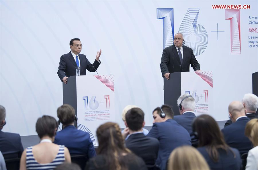 Chinese Premier Li Keqiang (L) and Bulgarian Prime Minister Boyko Borissov are seen during a press conference after the 7th leaders\' meeting of China and the Central and Eastern European Countries (CEEC) in Sofia, Bulgaria, July 7, 2018. Li joined Boyko Borissov, host of the 7th China-CEEC leaders\' meeting, and Prime Minister Andrej Plenkovic of Croatia, the next host country, in the press conference. (Xinhua/Li Tao)