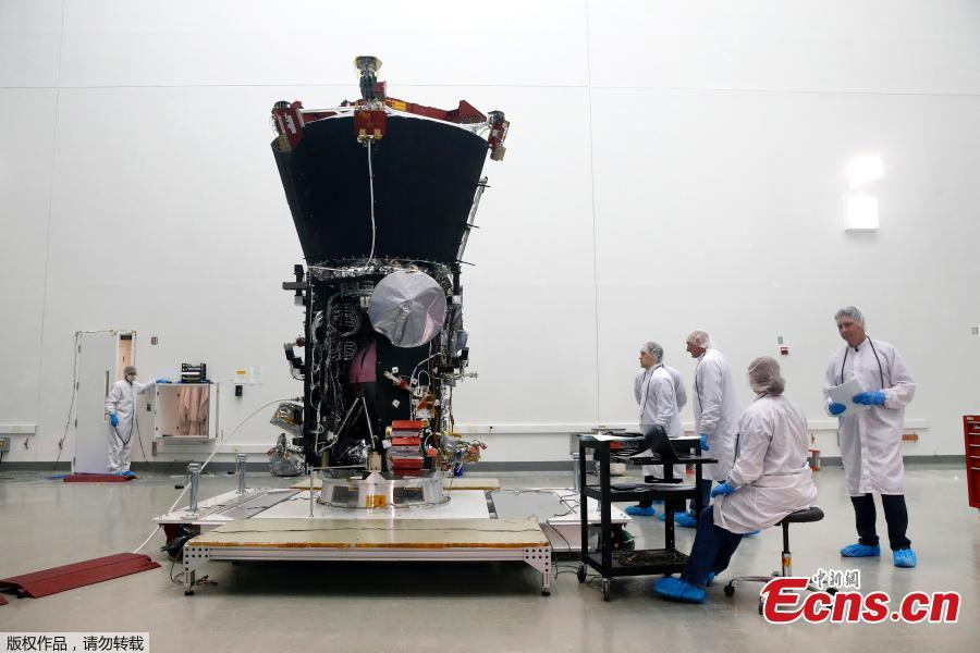 NASA\'s Parker Solar Probe sits inside a cleanroom at Goddard Space Flight Center, Wednesday, March 28, 2018, in Greenbelt, Md., as workers prepare it for launch. The spacecraft, which is scheduled to launch this summer, will travel closer to the Sun than any other spacecraft in history as it attempts to help researchers better understand stars throughout the universe.(Photo/Agencies)