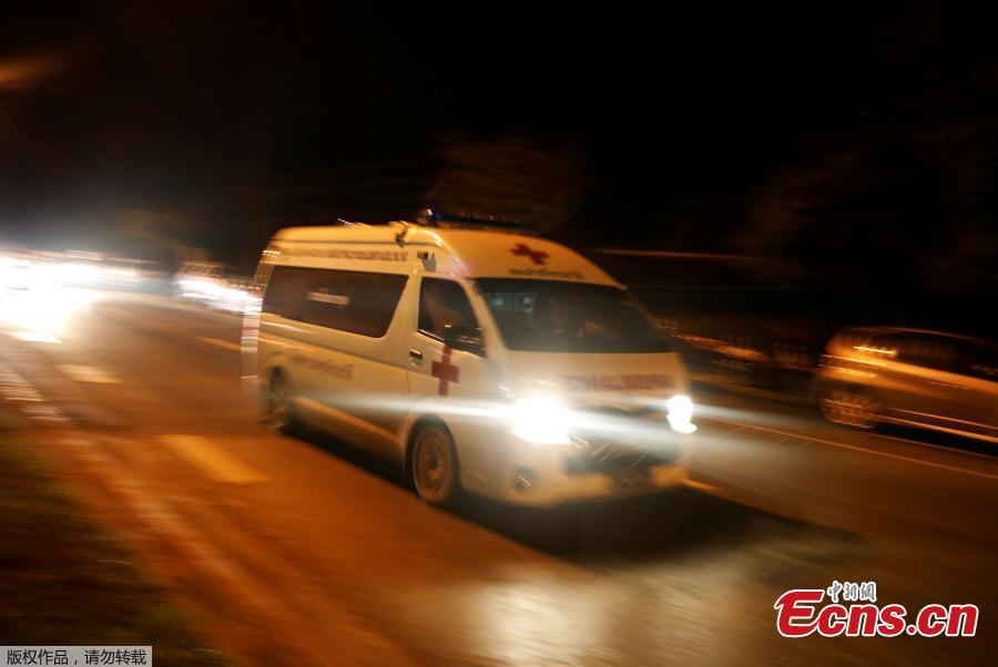 An ambulance believed to be carrying rescued schoolboys travels to a military helipad near Tham Luang cave complex in the northern province of Chiang Rai, Thailand, July 8, 2018. Four boys have exited a flooded cave in northern Thailand where they have been trapped for more than two weeks, a senior member of rescue operation's medical team said on Sunday. (Photo/Agencies)