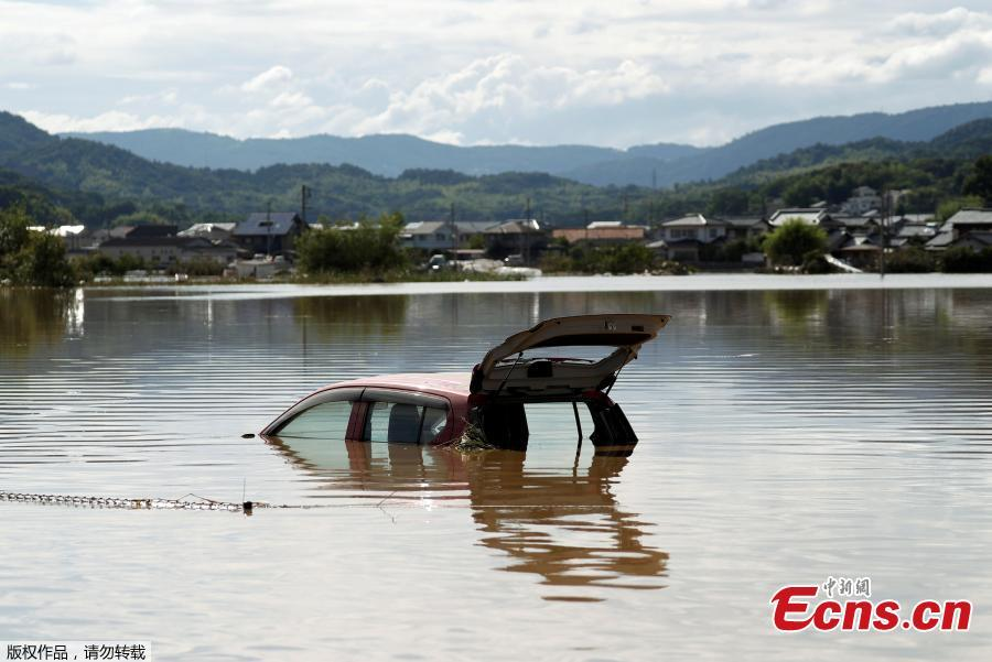 A car is submerged at a flooded area in Mabi town in Kurashiki, Okayama Prefecture, Japan, July 8, 2018. The death toll from torrential rain and landslides in western Japan rose to 88 people early on Monday, with dozens still missing after the rescue of more than 2,000 stranded in the city of Kurashiki.(Photo/Agencies)