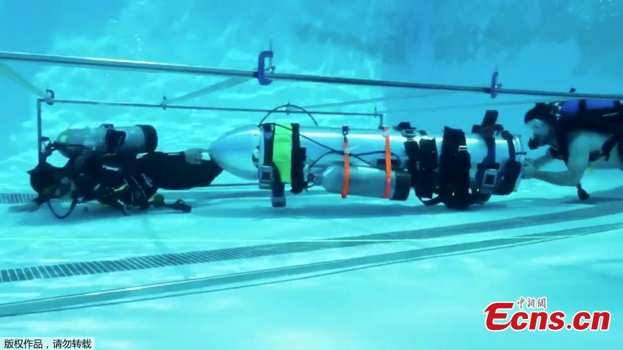 Elon Musk, the billionaire inventor and SpaceX founder, tweeted videos of his rescue submarine that can be used to extract a soccer team trapped inside a Thailand cave. The picture shows the tiny kid-sized submarine simulating maneuvering through a narrow passage. (Photo/Agencies)