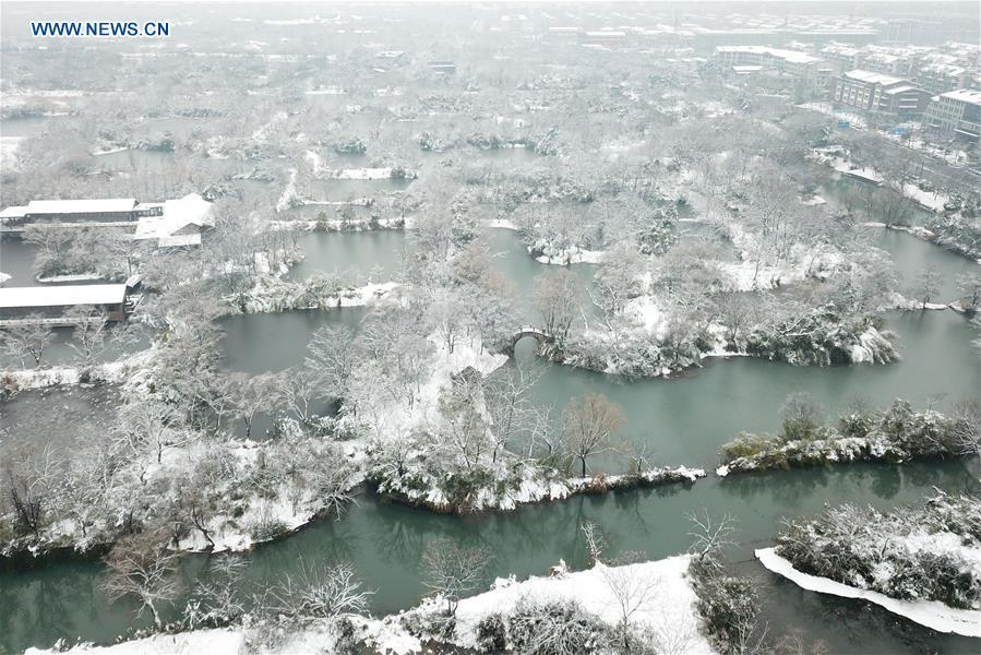 Aerial photo taken on Jan. 28, 2018 shows winter scenery of the Xixi wetland in Hangzhou, east China\'s Zhejiang Province. China, with a total wetland area of 53.6 million hectares, ranks first in Asia and fourth in the world, official data showed. The statistics were released by the National Forestry and Grassland Administration at the Eco Forum Global Annual Conference held in southwest China\'s Guizhou Province. China has 57 wetlands that are of international importance, 602 wetland nature reserves and 898 national wetland parks, according to the administration. In the country\'s wetland ecosystem, there are 4,220 species of plant and 2,312 species of animals, with the wetland protection rate reaching 49 percent, the statistics showed.(Xinhua/Huang Zongzhi)