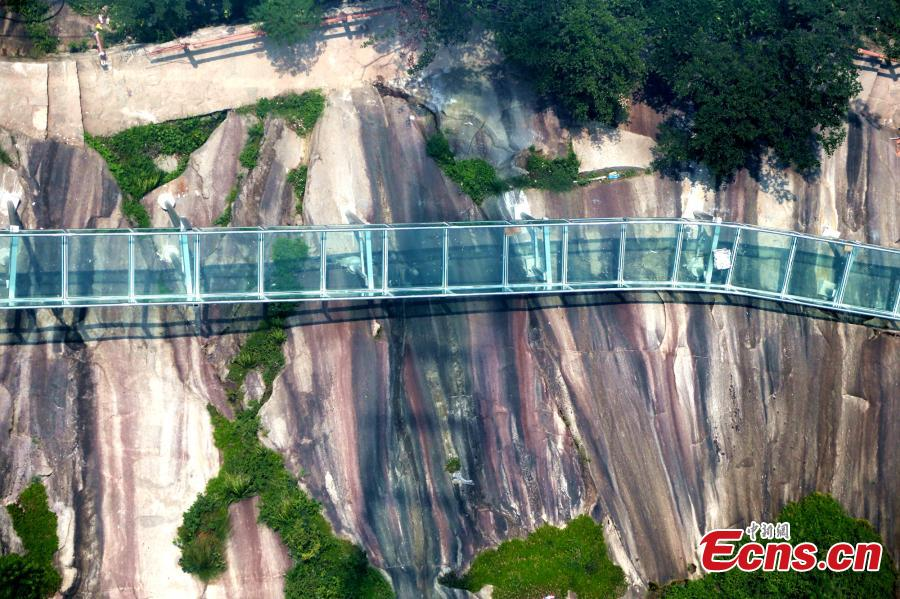 An aerial view of a waterslide over the Xiangma River in Lushan County, Central China's Henan Province, July 9, 2018. The 2.3-kilometer-long waterside under construction around a mountain slope and cliff has a vertical drop of 100 meters, earning it the title of the longest and most challenging waterslide in central China. (Photo: China News Service/Dong Fei)