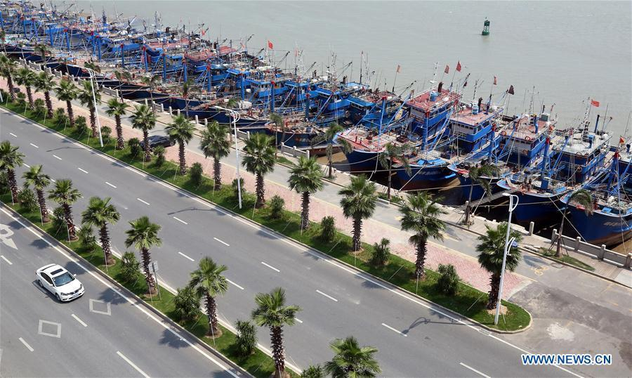 Fishing boats are seen at berth at a harbor in Quanzhou City, southeast China\'s Fujian Province, July 9, 2018. A yellow-level alert has been issued and third-level emergency response has been activated to cope with approaching typhoon Maria, the eighth typhoon this year, in China\'s coastal provinces. (Xinhua/Zhang Jiuqiang)