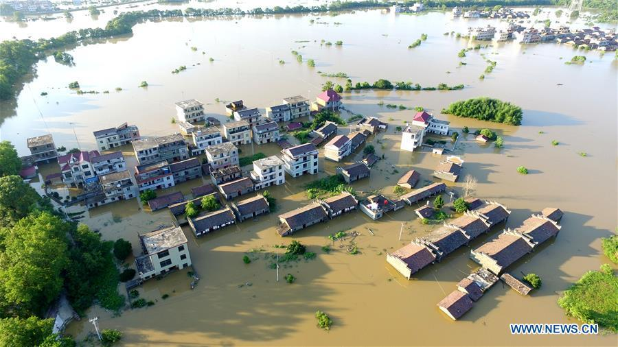 Aerial photo taken on July 8, 2018 shows the flooded area in Qiaoxi Village of Maxu Township of Fuzhou City, east China\'s Jiangxi Province. Flood caused by heavy rain damaged crops and housings in Maxu Township and rescue groups were set up to help the affected people. (Xinhua/He Jianghua)