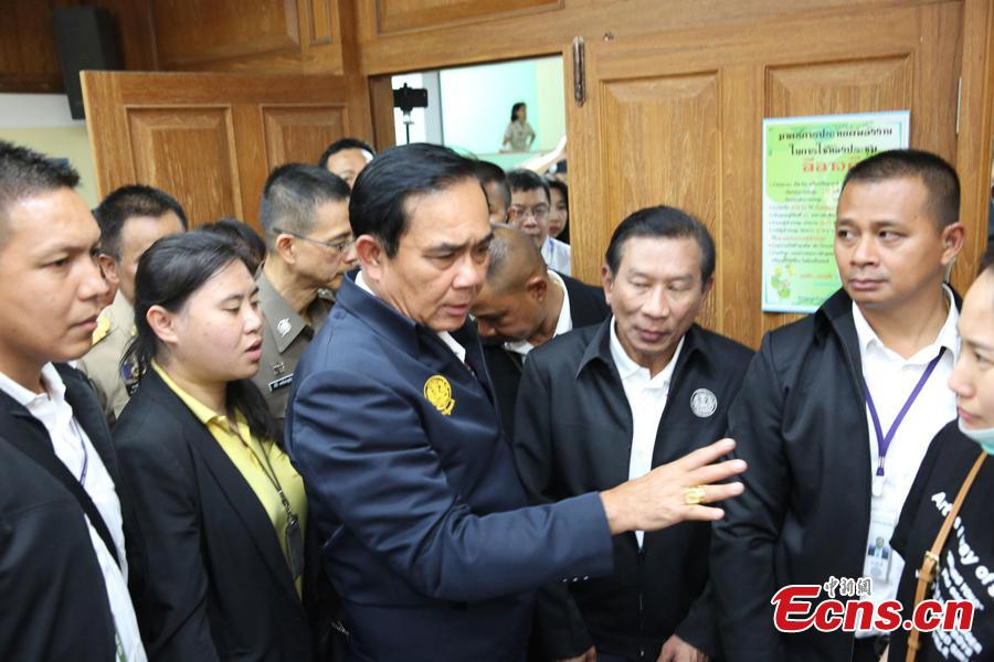 Thai Prime Minister Prayut Chan-o-cha visits the command center for rescue operations in the Phuket boat accident, at Chalong Pier in the tourist attraction island of Phuket, July 9, 2018. He later visited Chinese survivors in local hospitals, expressed his condolence to the victims and pledged to make all-out rescue efforts. (Photo: China News Service/Wang Gang)