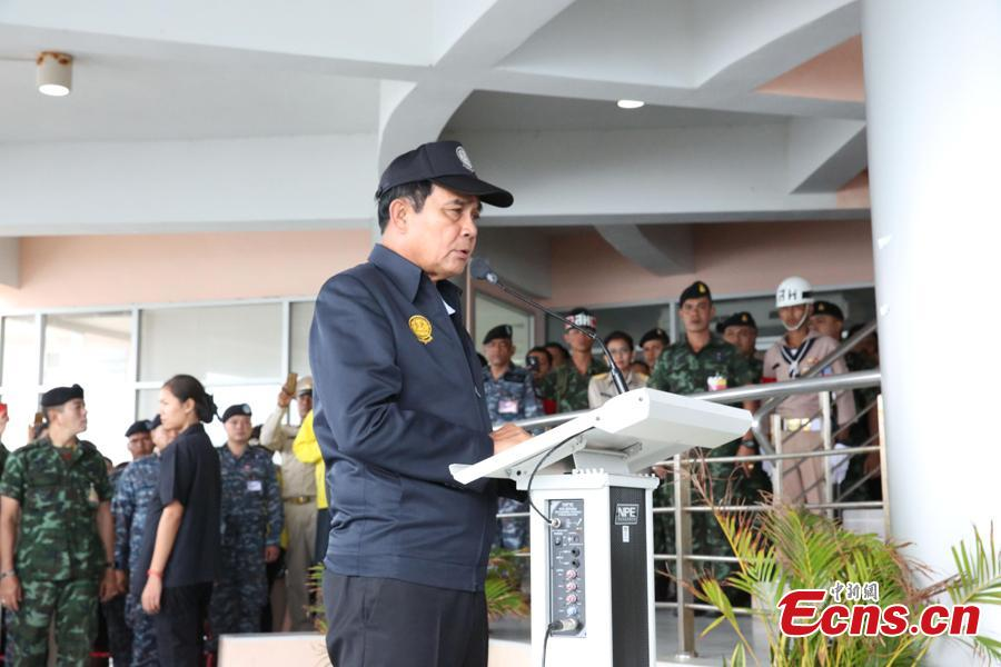 Thai Prime Minister Prayut Chan-o-cha holds a press conference at the command center for rescue operations in the Phuket boat accident, at Chalong Pier in the tourist attraction island of Phuket, July 9, 2018. He later visited Chinese survivors in local hospitals, expressed his condolence to the victims and pledged to make all-out rescue efforts. (Photo: China News Service/Wang Gang)