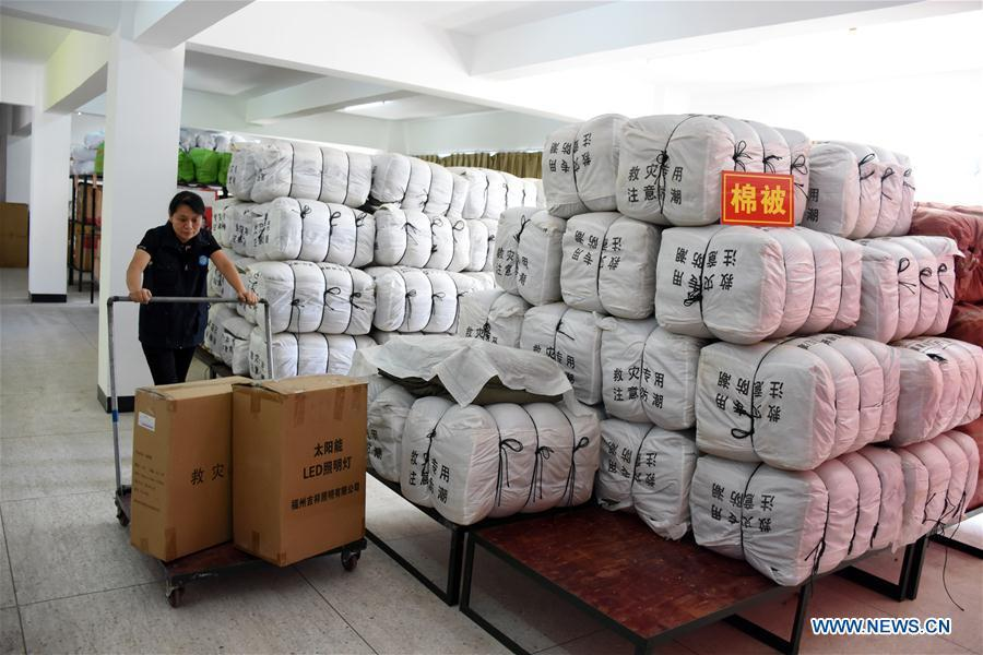 An official prepares relief materials at Yongding District of Longyan City, southeast China\'s Fujian Province, July 9, 2018. A yellow-level alert has been issued and third-level emergency response has been activated to cope with approaching typhoon Maria, the eighth typhoon this year, in China\'s coastal provinces. (Xinhua/Su Gaolong)